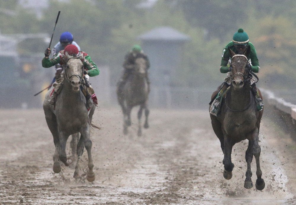 Exaggerator, right, with Kent Desormeaux aboard wins the 141st Preakness Stakes horse race at Pimlico Race Course, Saturday, May 21, 2016, in Baltimore. Cherry Wine, left, with Corey Lanerie aboard places second.