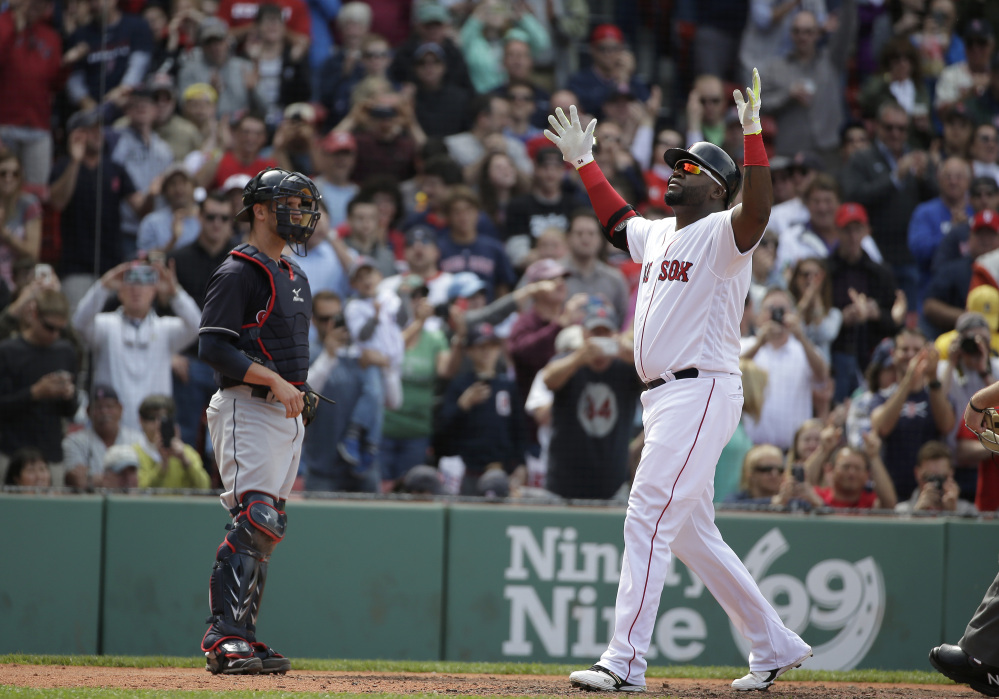 The Associated Press Red Sox designated hitter David Ortiz celebrates after hitting a home run in the fifth inning of Boston's 5-2 win over Cleveland on Sunday at Fenway Park.