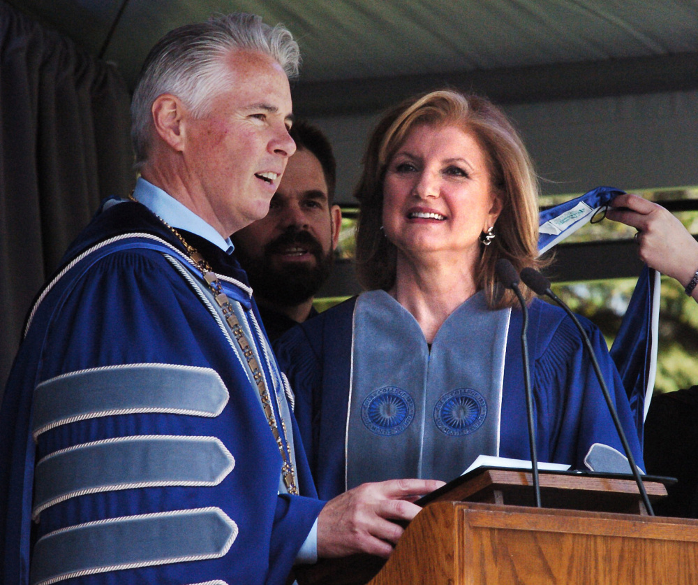 Colby College President David Greene confers an honorary degree of doctor of detters on commencement speaker Arianna Huffington, co-founder of the Huffington Post, on Sunday.