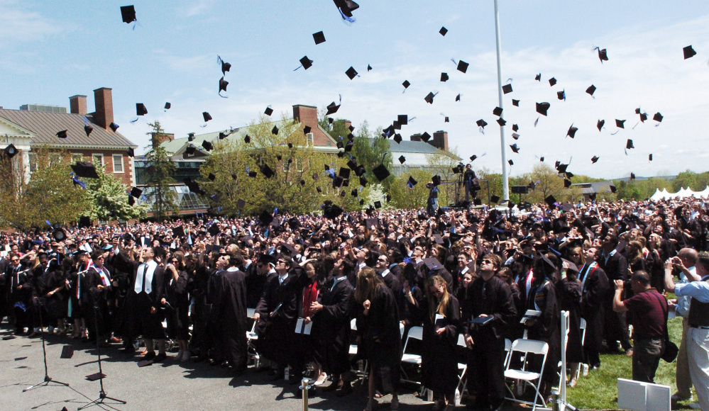 Colby College graduates throw their mortarboards in the air following commencement in Waterville on Sunday.