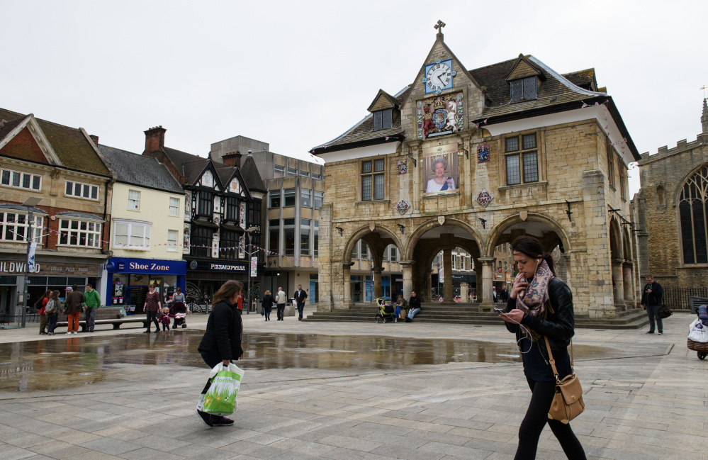 A portrait of Queen Elizabeth II overlooks a square in central Peterborough in England. Peterborough was rated in a recent poll as the second-most Eurosceptic place in Britain.