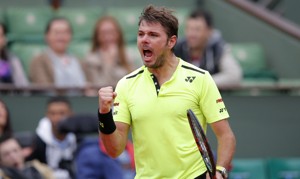 Stan Wawrinka celebrates a winning point Monday against Lukas Rosol in the opening round of the French Open. Wawrinka, the defending champ, won 4-6, 6-1, 3-6, 6-3, 6-4.
