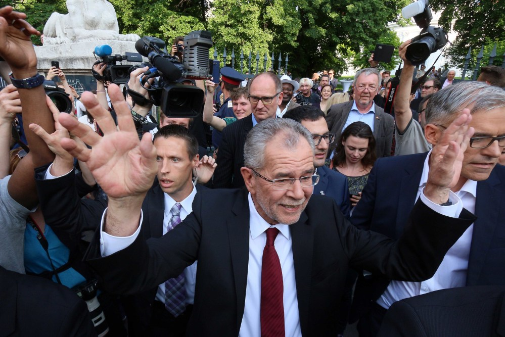 Alexander Van der Bellen winner of Austria's presidential election waves to his supporters in Vienna, Austria, Monday, May 23, 2016. Left-leaning candidate Alexander Van der Bellen won the election to become Austrian president Monday, but his right-wing rival was only narrowly behind, a result that reflects the growing strength of Europe's anti-EU political movements.  (AP Photo/Ronald Zak)