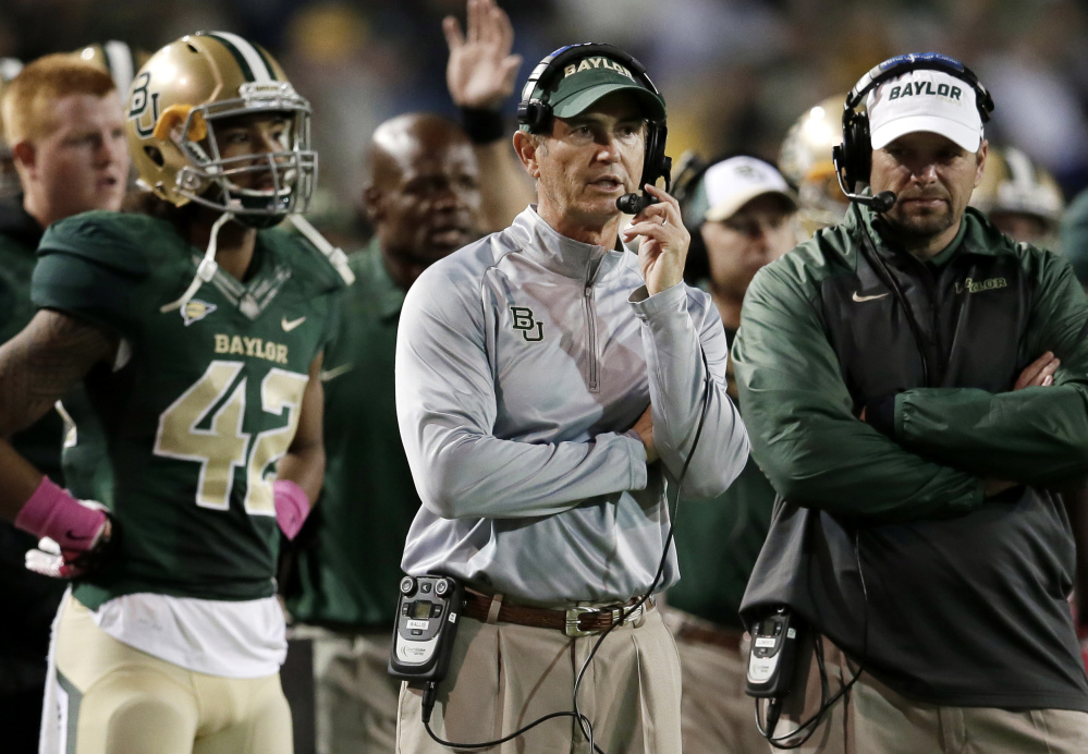 Baylor football coach Art Briles, center, was fired Thursday in response to questions about the program's handling of sexual assault complaints against players.