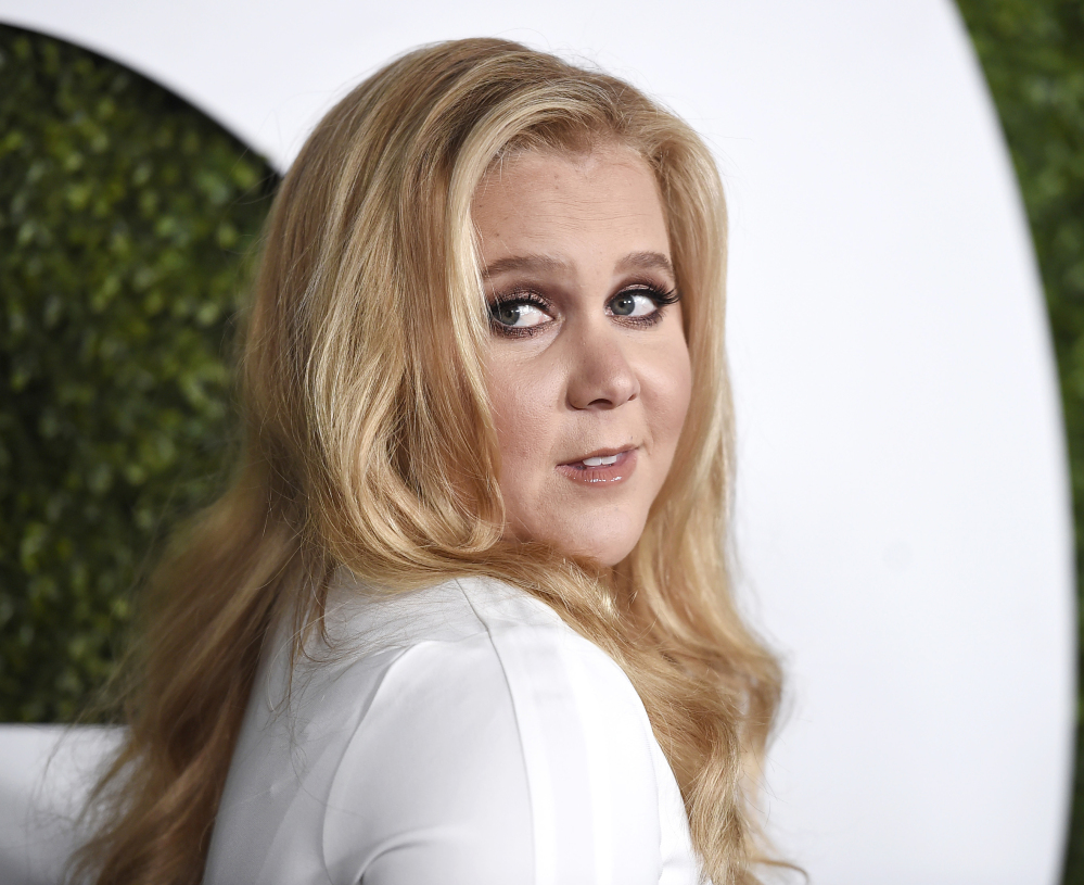 Amy Schumer arrives at the GQ Men of the Year Party at the Chateau Marmont in Los Angeles in 2015. Schumer has blasted critics of her looks on social media.