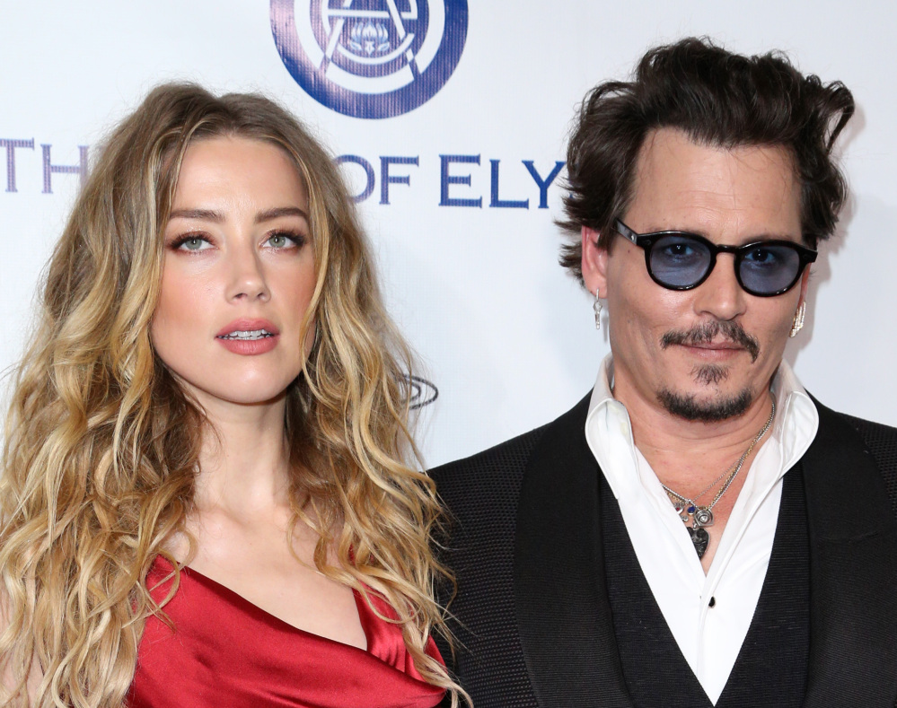 Amber Heard and Johnny Depp arrive at an event in Culver City, Calif., in January. A judge ruled Friday that Depp shouldn't contact Heard until a hearing on June 17. The Associated Press