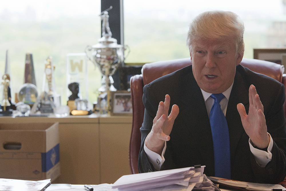 Donald Trump responds to a question during an interview at his office in Trump Tower in May. (The Associated Press)