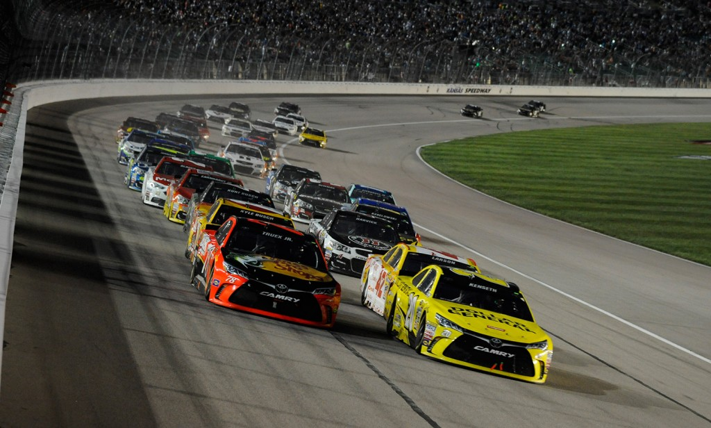 Sprint Cup Series driver Martin Truex Jr. (78), left, and Sprint Cup Series driver Matt Kenseth (20), right, lead the pack during a Sprint Cup Series race at Kansas Speedway in Kansas City, Kan., Saturday, May 7, 2016. The Associated Press