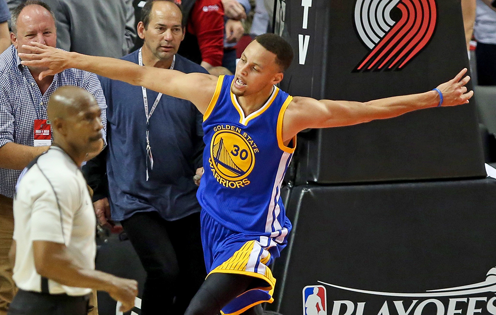 Golden State Warriors guard Stephen Curry  celebrates a 132-125 win in overtime over the Portland Trail Blazers in game four of the second round of the NBA Playoffs. Jaime Valdez-USA TODAY Sports