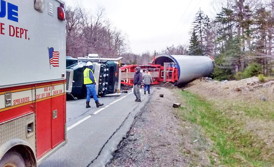A loaded truck hauling a windmill base from the Quebec border to a wind project in Bingham rolled over Monday when the driver lost control on a corner in Johnson Mountain Township. Photo courtesy of West Forks Volunteer Fire Department