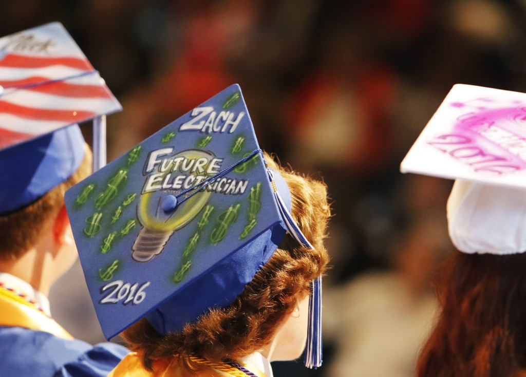 OLD ORCHARD BEACH, ME - JUNE 5: A graduate announces his future plans on his cap at Old Orchard Beach High School graduation.(Photo by Jill Brady/Staff Photographer)