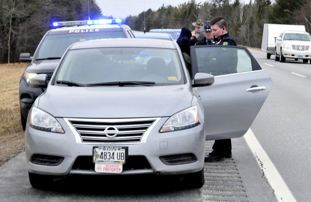 Skowhegan police Detective Katelyn Treylino searches the contents of a car she pulled over on Interstate 95 in Newport after a chase that began in Skowhegan in February and resulted in the arrest of Ryan Galouch, a Belgrade firefighter at the time.