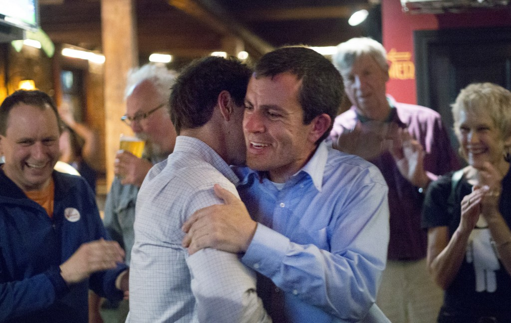 Ben Chipman, right, is greeted by state Sen. Justin Alfond at Brian Boru in Portland on Tuesday night as they celebrate Chipman's win in the Senate District 28 primary. Derek Davis/Staff Photographer