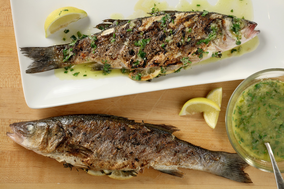 For the herb-grilled Mediterranean sea bass recipe, the fish are drizzled after grilling with a lemon, ginger and chive finishing sauce.