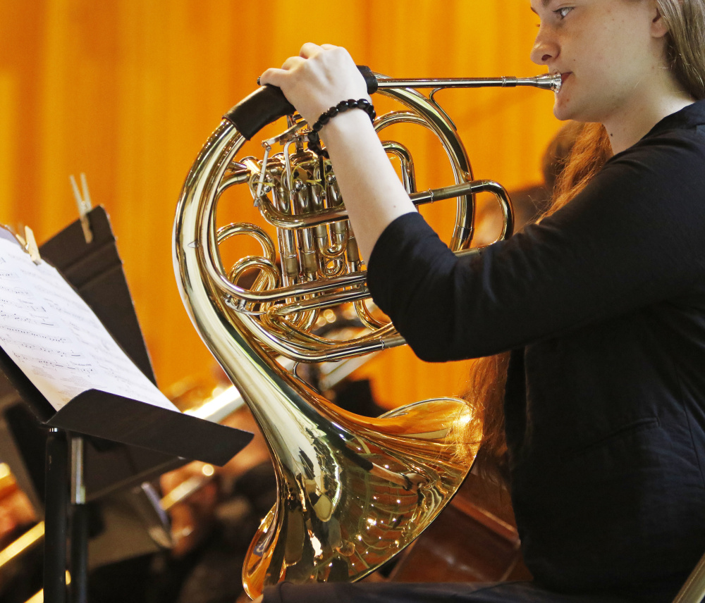OLD ORCHARD BEACH, ME - JUNE 5: Samantha Boch, a sophomore, plays her french horn with the band during Old Orchard Beach High School graduation.(Photo by Jill Brady/Staff Photographer)