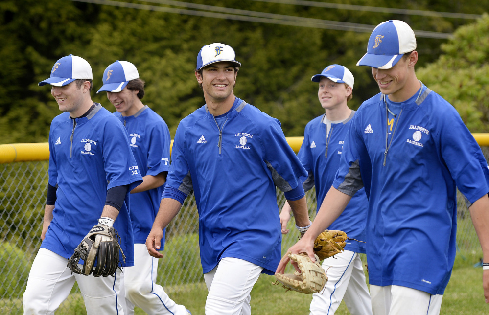 Connor Aube, center, is the unquestioned leader of a Falmouth High baseball team that completed an undefeated Western Maine Conference regular season and will face tougher competition in the playoffs.