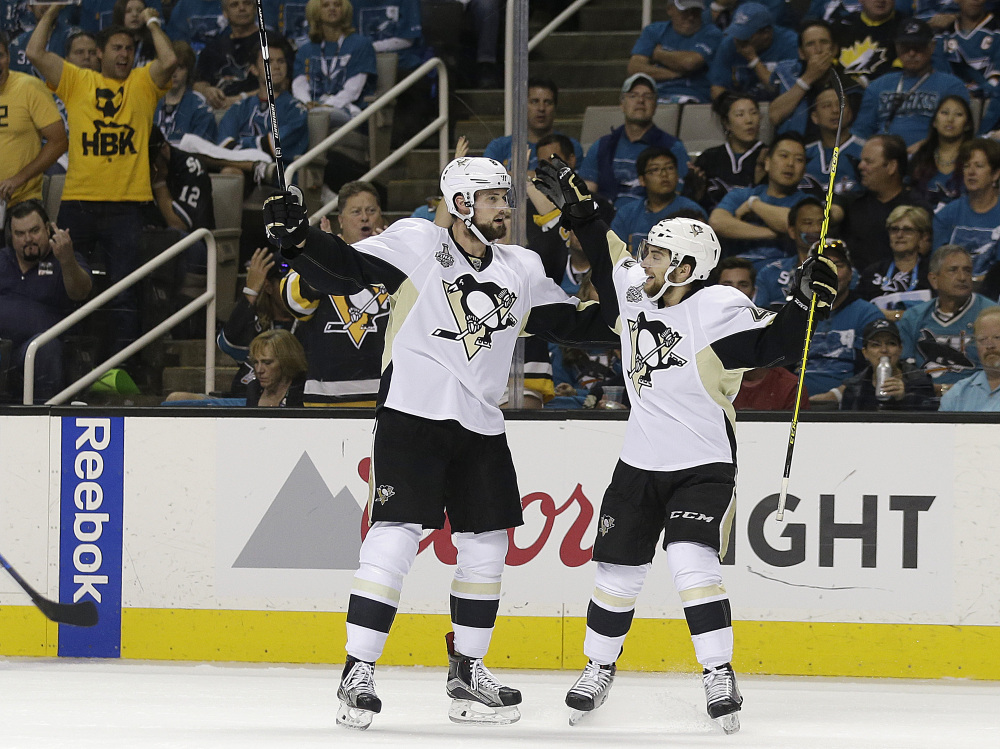 Penguins defenseman Brian Dumoulin, left, is congratulated by Conor Sheary after scoring in the first period of Game 6 of the Stanley Cup finals. The Penguins clinched the championship with a 3-1 victory.