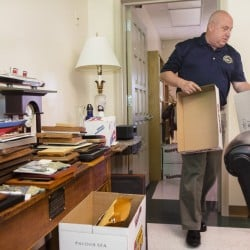 Outgoing Westbrook Superintendent of Schools Marc Gousse packs belongings from his office on Friday. He's changing jobs to become the superintendent of schools on Mount Desert Island, a smaller district with a higher salary, starting in July.