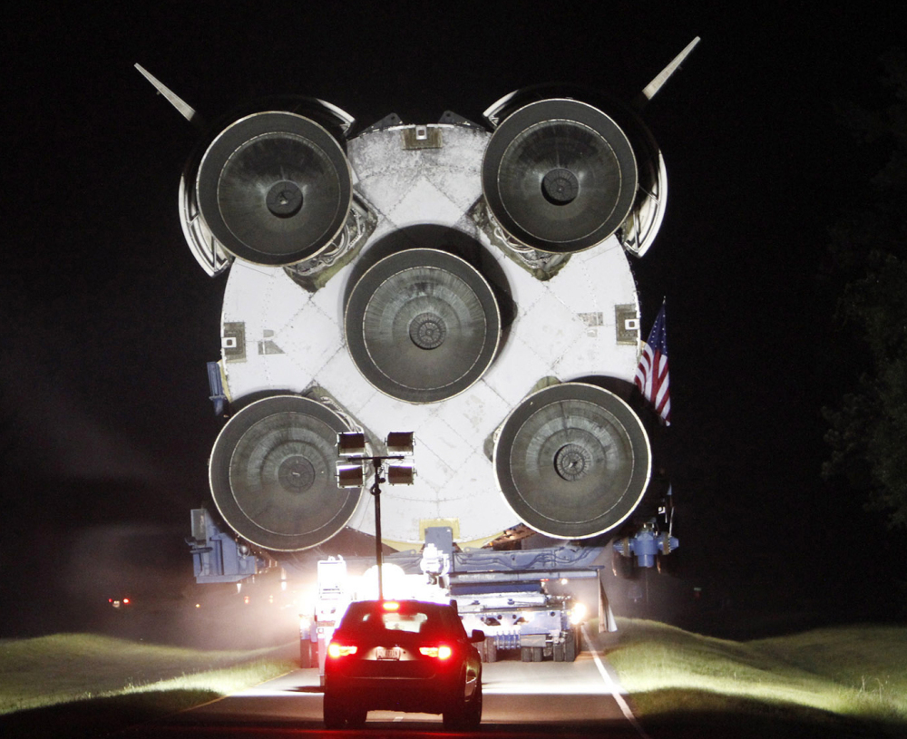 An unused Saturn V rocket booster is moved from a NASA facility along a Mississippi highway Monday night.