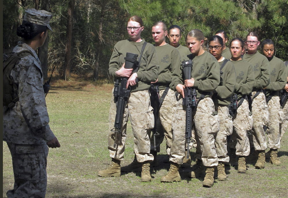 Recruits stand at a Marine training center in South Carolina in 2013. Nearly 86 percent of women recently failed combat-readiness tests, while less than 3 percent of men did. Associated Press/Bruce Smith