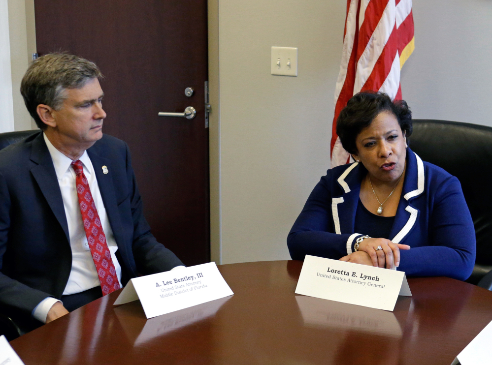 Attorney General Loretta Lynch, right, conducts a meeting Tuesday in Orlando, Fla., with U.S. Attorney Lee Bentley concerning the Pulse nightclub mass shooting.