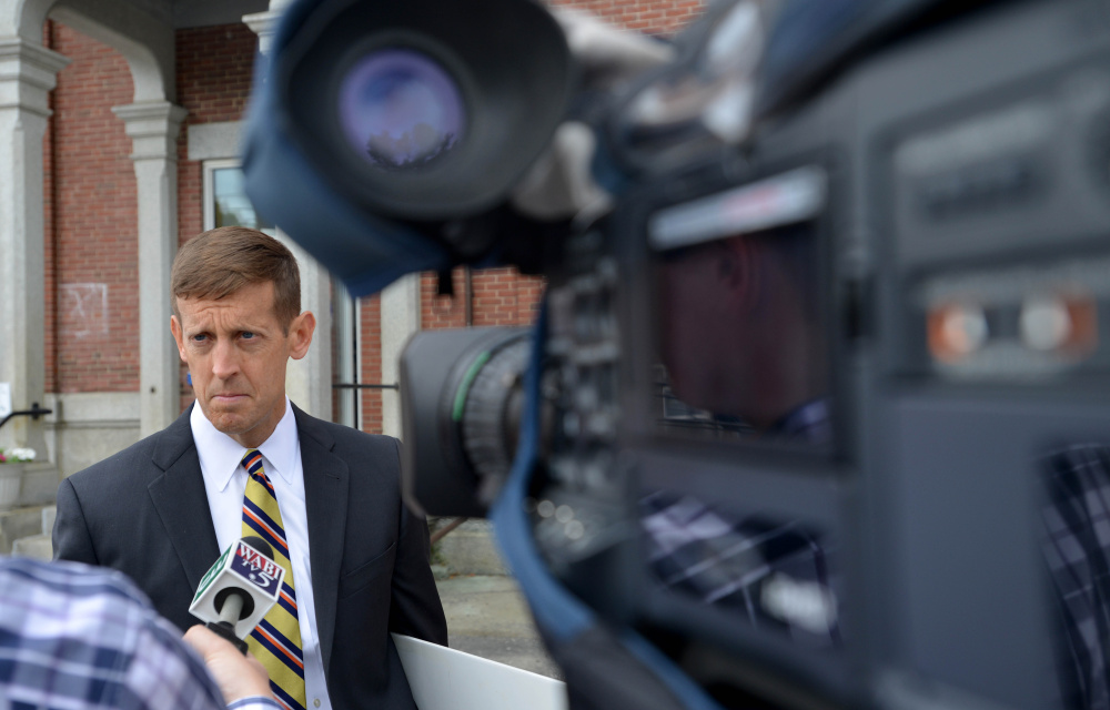 Walter McKee, Claudia Viles' defense attorney, speaks with news media representatives Wednesday after his client was convicted in Somerset County Superior Court in Skowhegan.