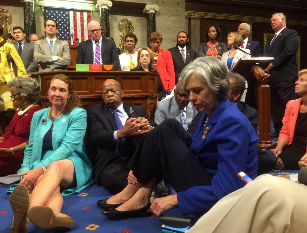 "A photo shot and tweeted from the floor of the U.S. House of Representatives shows Democrats staging a sit-in Wednesday on the House floor ""to demand action on common-sense gun legislation."""