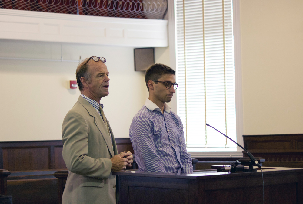 Lewiston attorney Allan Lobozzo, left, accompanies former Sacopee Valley High ed-tech Zachariah Sherburne, 24, who pleaded not guilty Wednesday in Oxford County Unified Court in South Paris to a charge that he had sex with a 16-year old student in Oxford.