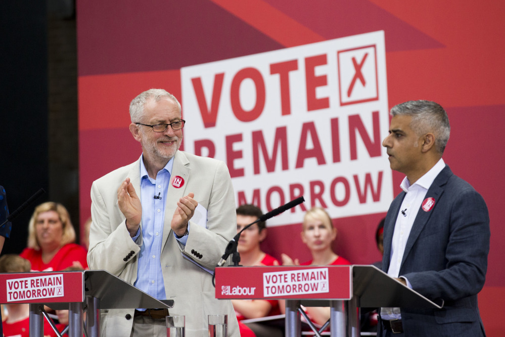 The leader of Britain's opposition Labour Party Jeremy Corbyn, left, applauds London mayor Sadiq Khan as he makes an address during a European Referendum