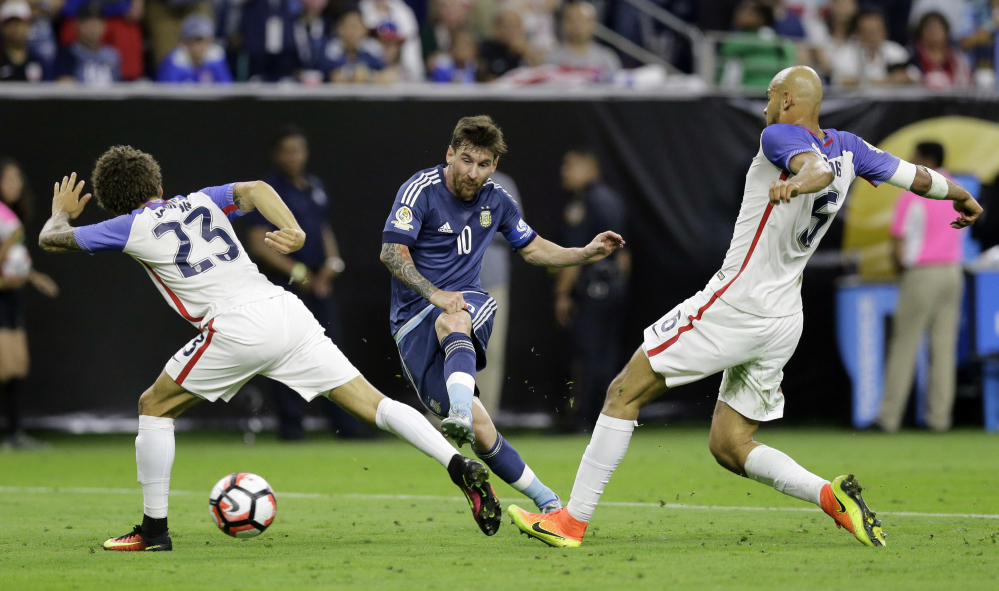Argentina's Lionel Messi, center, scorches a shot on goal past Fabian Johnson, left, and Matt Besler of the United States during Argentina's 4-0 win in the Copa America Centenario semifinal at Houston on Tuesday.