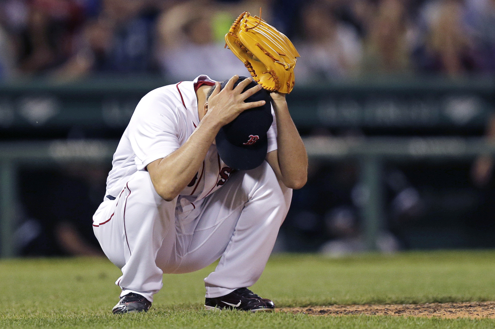 Associated Press/Charles Krupa Red Sox reliever Koji Uehara grabs his head shortly after giving up a two-run home run to Chicago's Melky Cabrera, which tied the game at 6-6, in the eighth inning Wednesday night at Fenway Park.