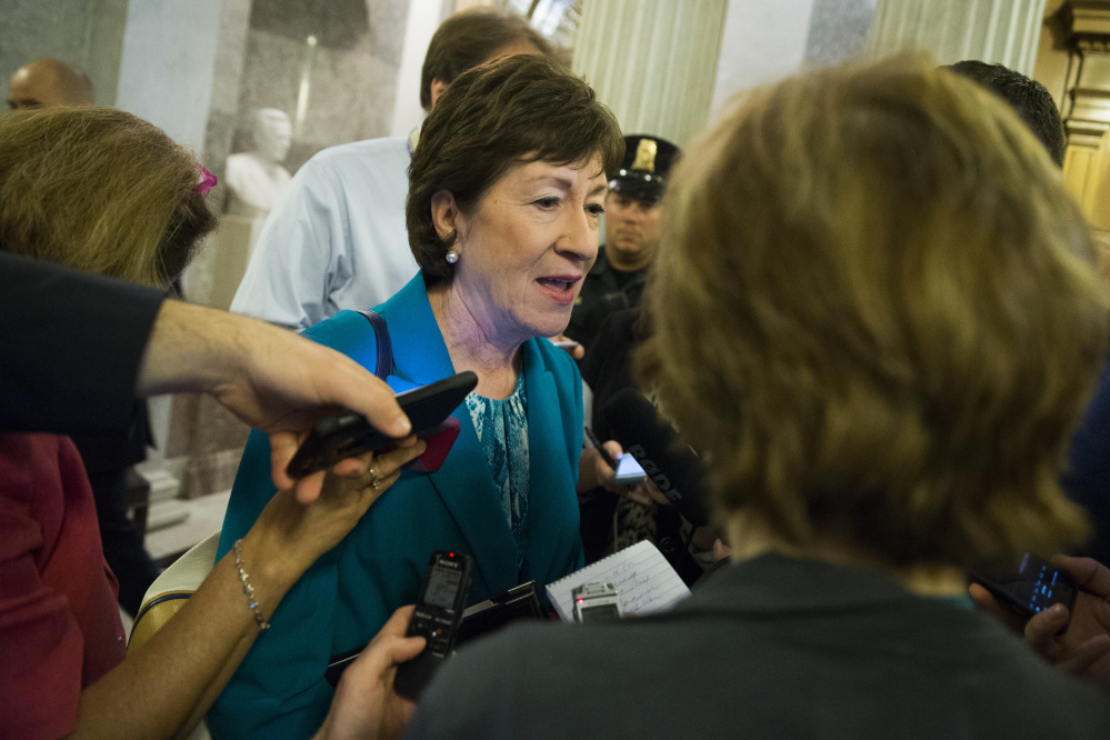 Maine Sen. Susan Collins speaks to reporters Thursday on Capitol Hill about the prospects for her compromise legislation restricting access to guns.