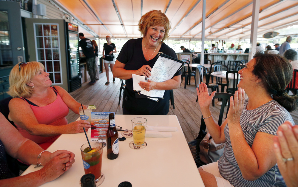 Ann LePage chats with diners after taking their order at McSeagull's restaurant in Boothbay Harbor on Thursday. The governor's wife says she doesn't tell customers or co-workers who she is unless they ask.