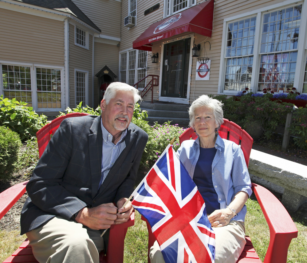 Jay Paulus and Lisa Bussey sit outside Freeport's Bridgham & Cook store. Bussey says Britain's vote to exit the European Union could both help and hurt the British goods store.