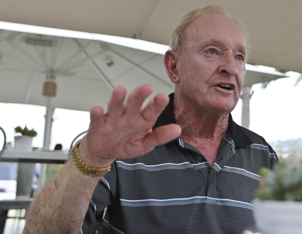 Rod Laver, now 77, knows how difficult it is to win a calendar-year tennis Grand Slam. He's the last man to do it, in 1969, and hopes Novak Djokovic can match him.
