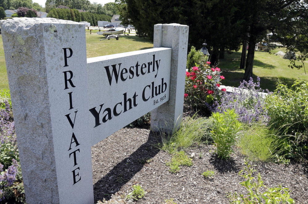 In this Monday, June 20, 2016 photo, a granite sign outside the Westerly Yacht Club is seen in Westerly, R.I. Wives can join the club as associate, non-voting members, but unmarried women can't. A vote to change the nearly century-old policy failed last week, with 171 men voting to uphold it. Women, and many men, are not happy. (AP Photo/Elise Amendola)