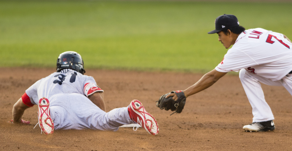 Portland's Tzu-Wei Lin is late with the tag as Reading's Dylan Cozens slides safely into second with a third-inning double at Hadlock Field on Friday,  Carl D. Walsh/Staff Photographer