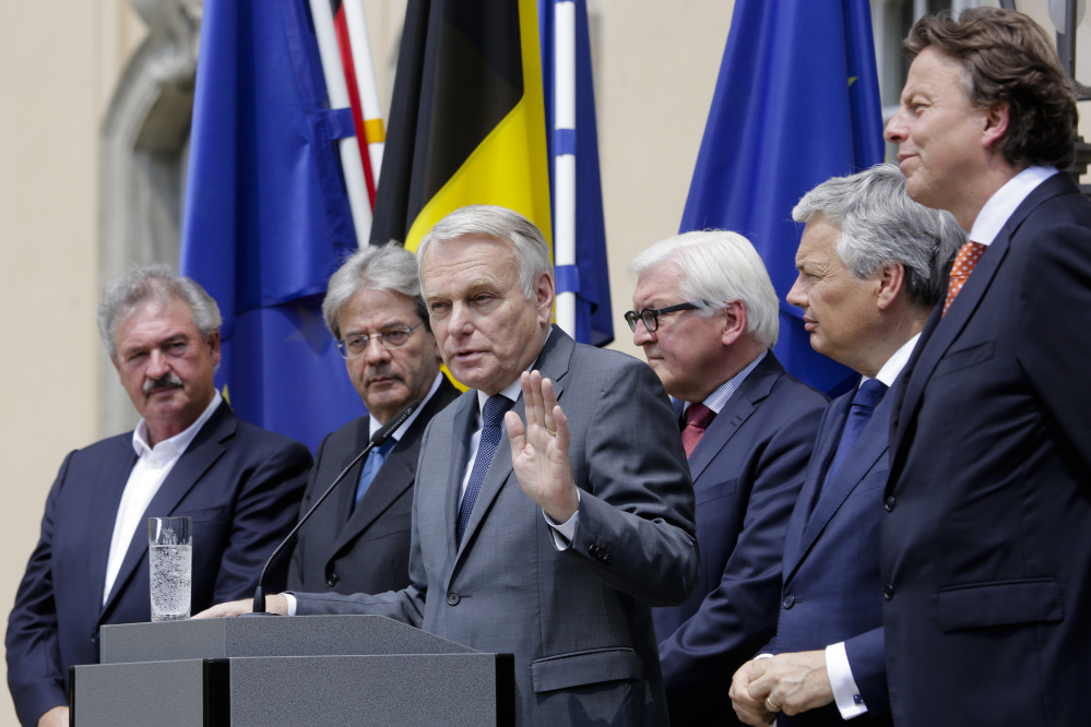 The foreign ministers from the European Union's founding six nations, Jean Asselborn from Luxemburg, Paolo Gentiloni from Italy, Jean-Marc Ayrault from France, Frank-Walter Steinmeier from Germany, Didier Reynders from Belgium and Bert Koenders from the Netherlands, brief the media after a meeting on the Brexit vote, in Berlin on Saturday.
