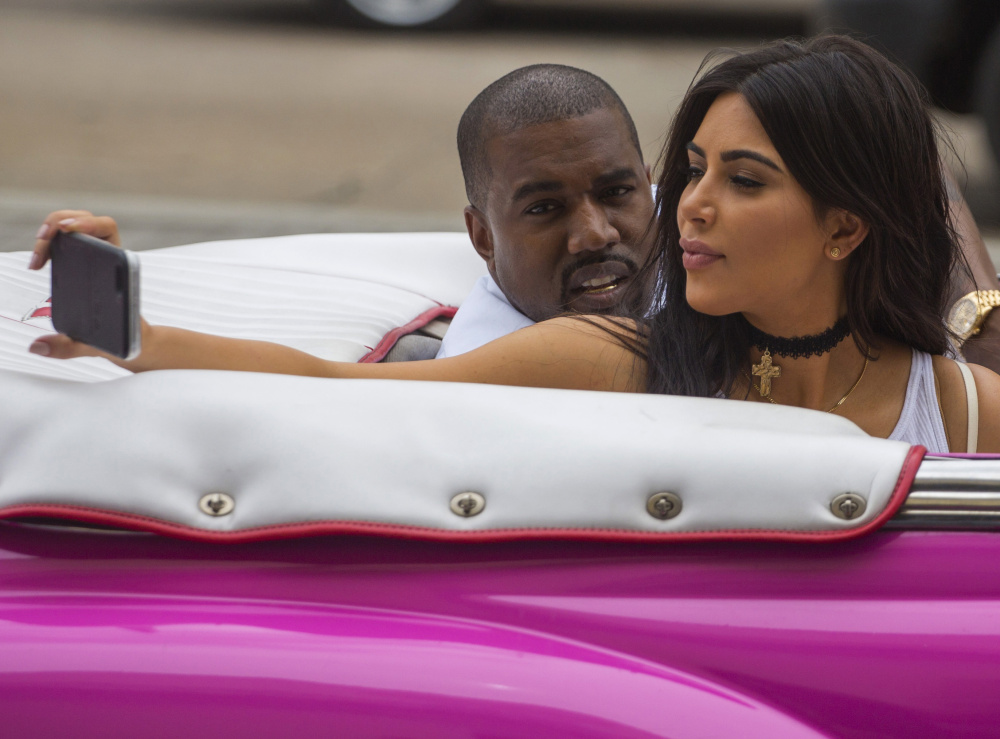 Kanye West and his wife, Kim Kardashian, appear in his