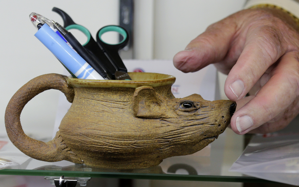 Whitey Bulger's coveted rat-shaped pencil holder, a nod to the gangster's longtime status as an FBI informant, sold for $3,600 at auction Saturday, according to The Boston Globe.