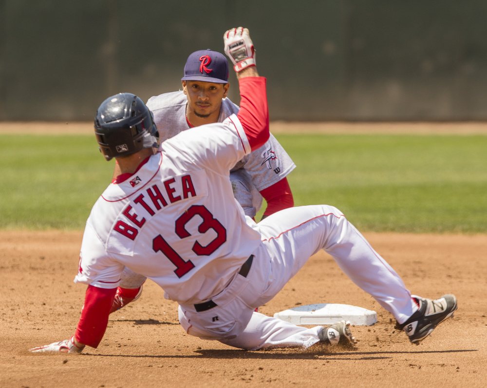 Portland's Danny Bethea slides late into second as Reading's Angelo Mora waits to place the tag at Hadlock Field in Portland on Sunday.   Carl D. Walsh/Staff Photographer