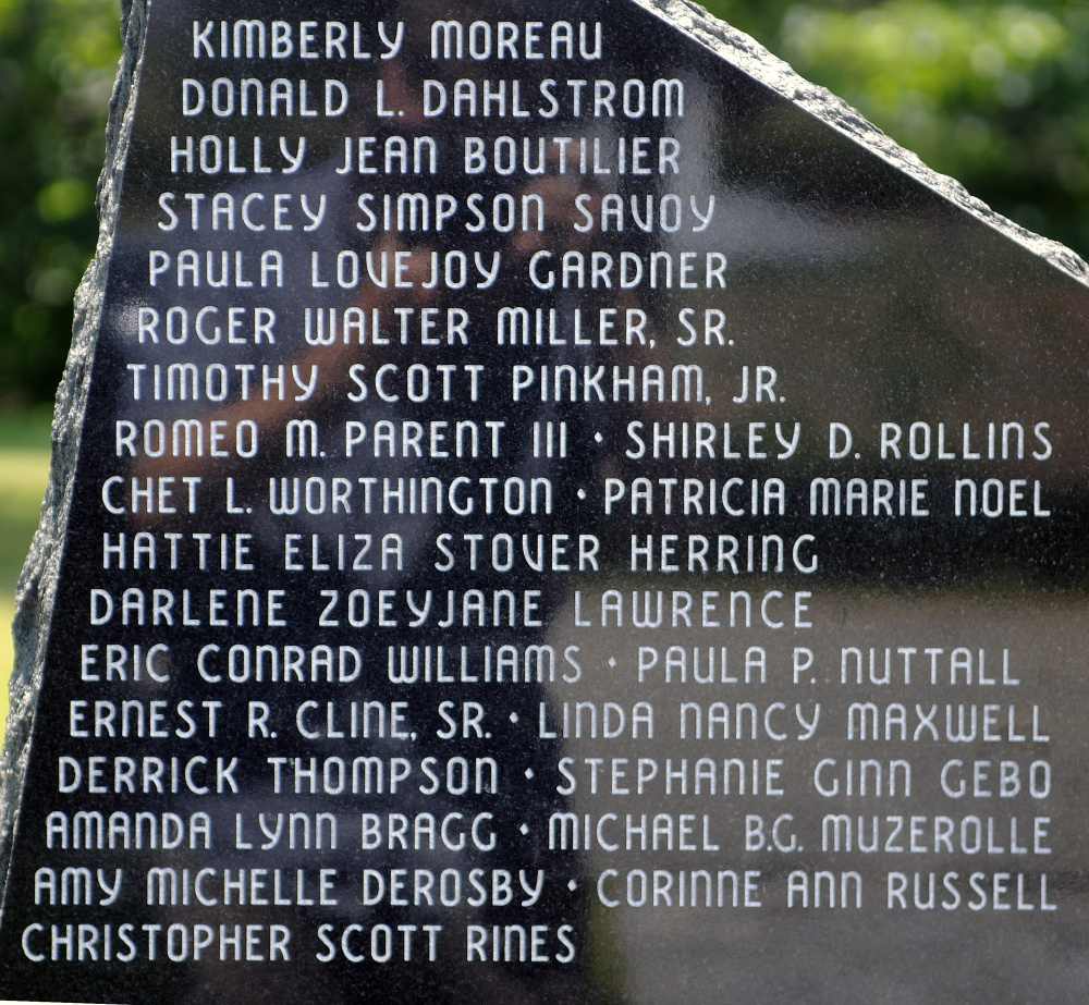 Some of the 107 names on the Maine Murder Victims' Memorial monument in Augusta, including, at the bottom, the 13 added this year.