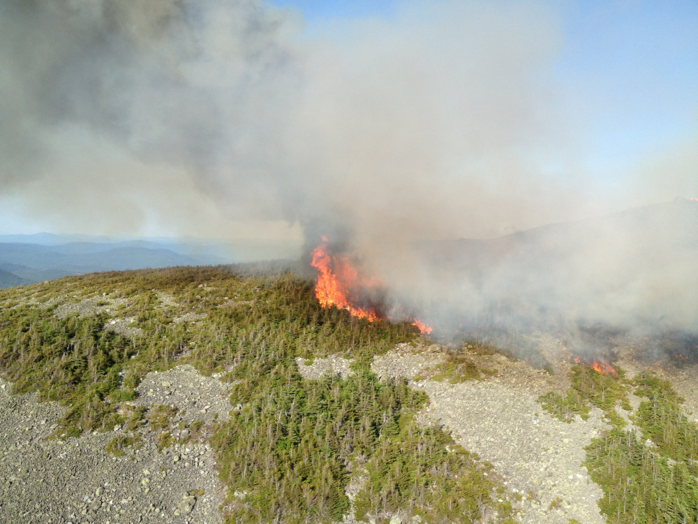 Fire burns near the summit of Mount Abraham on Sunday. The fire was still going Monday night.