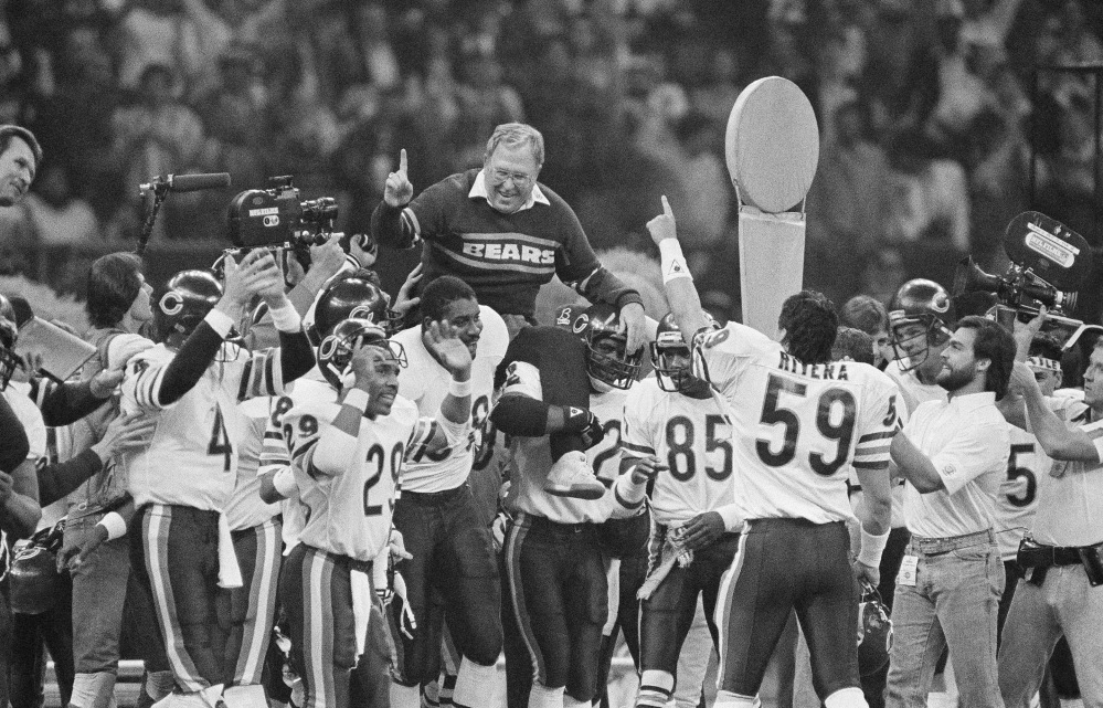 Chicago Bears defensive coordinator Buddy Ryan is carried off the field by the team after the Bears beat the New England Patriots 46-10 in Super Bowl XX in New Orleans.