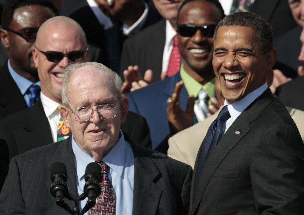 President Barack Obama, right, smiles at former defensive coordinator Buddy Ryan, speaking left, as he stands with the 1985 Super Bowl XX Champions Chicago Bears football team during a ceremony on the South Lawn of the White House in Washington. Buddy Ryan, who coached two defenses that won Super Bowl titles and whose twin sons Rex and Rob have been successful NFL coaches, died Tuesday, June 28, 2016. He was 82. (AP Photo/Pablo Martinez Monsivais, File)