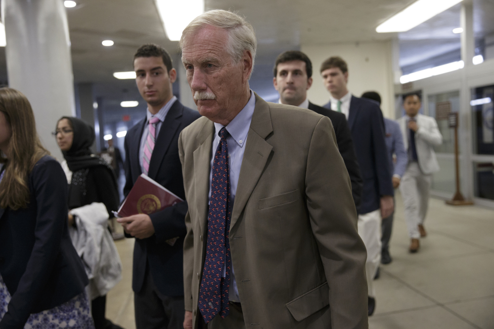 Sen. Angus King, I-Maine, and other senators head to the Senate chamber on Capitol Hill in Washington on Wednesday to vote on a rescue package for debt-stricken Puerto Rico, just two days before the island is expected to default on a $2 billion debt payment.