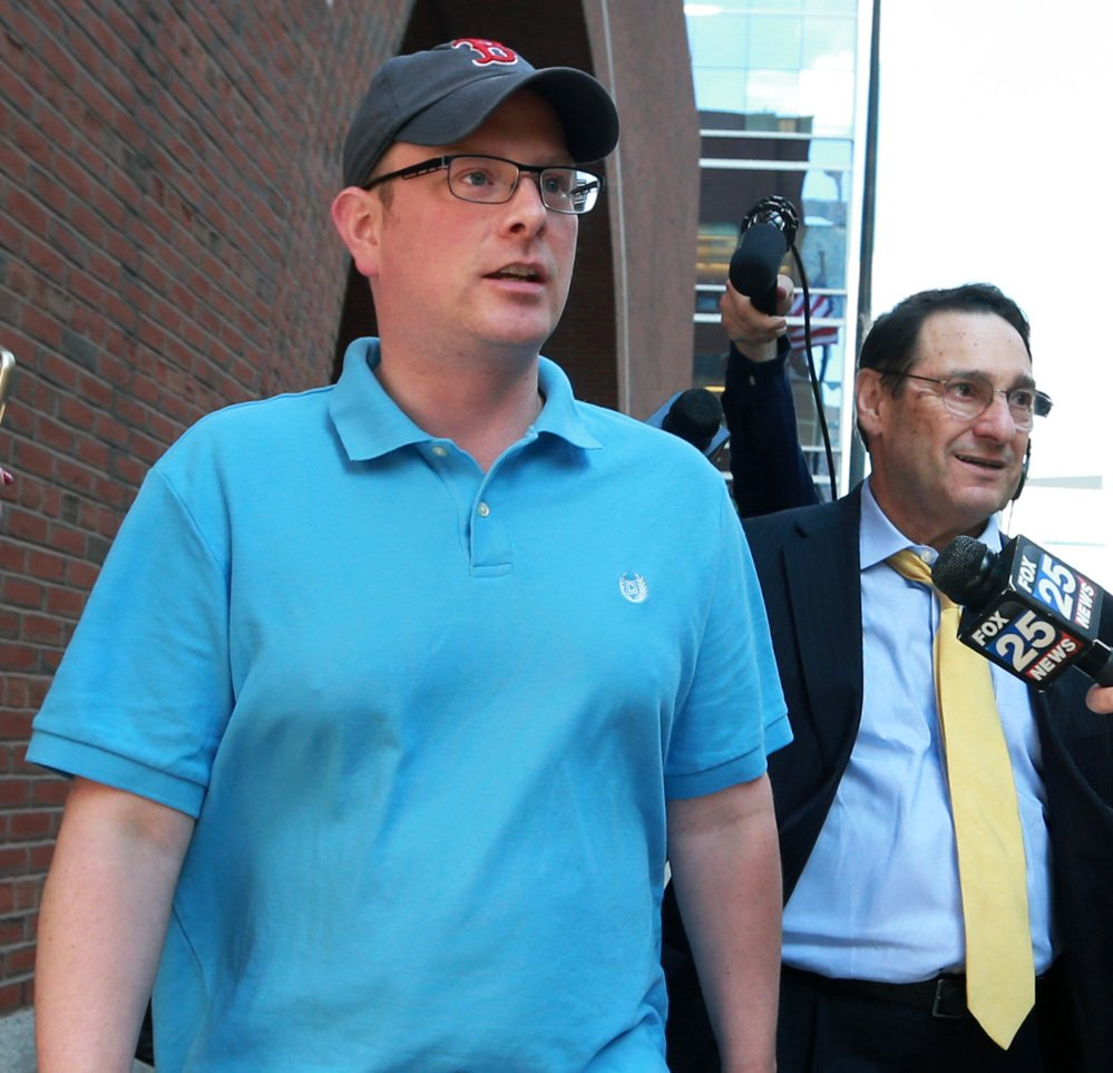 Timothy Sullivan leaves the Moakley Federal Courthouse in Boston on Wednesday after his arraignment.