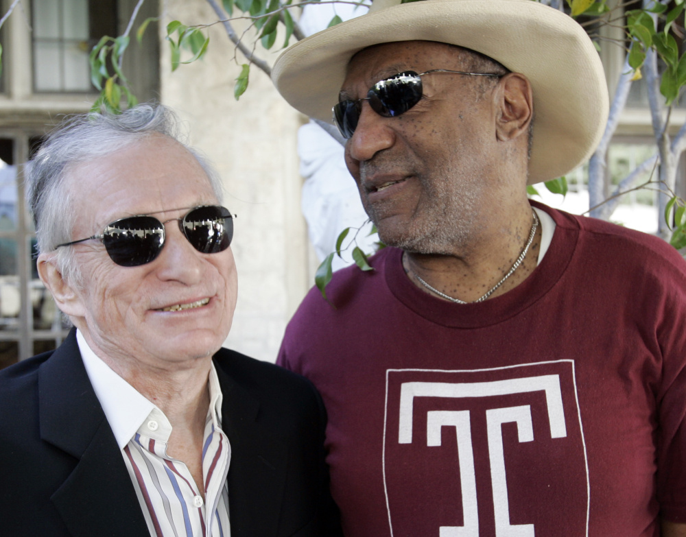 Bill Cosby and Hugh Hefner greet each other at a party in 2008.Hefner says the lawsuit against him is barred by the statute of limitations and is not supported by facts.