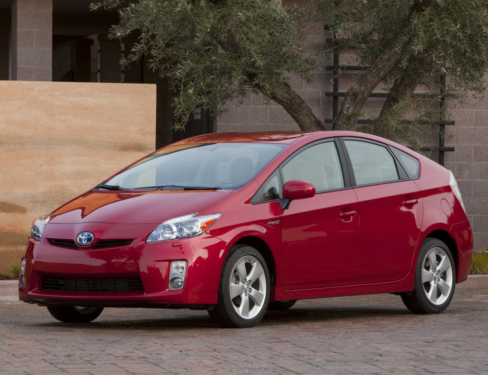 Toyota is recalling 1.4 million Prius hybrid cars from 2009 through 2015 over concerns that the side curtain air bags could inflate without cause. A separate recall involves possible fuel tank cracks.