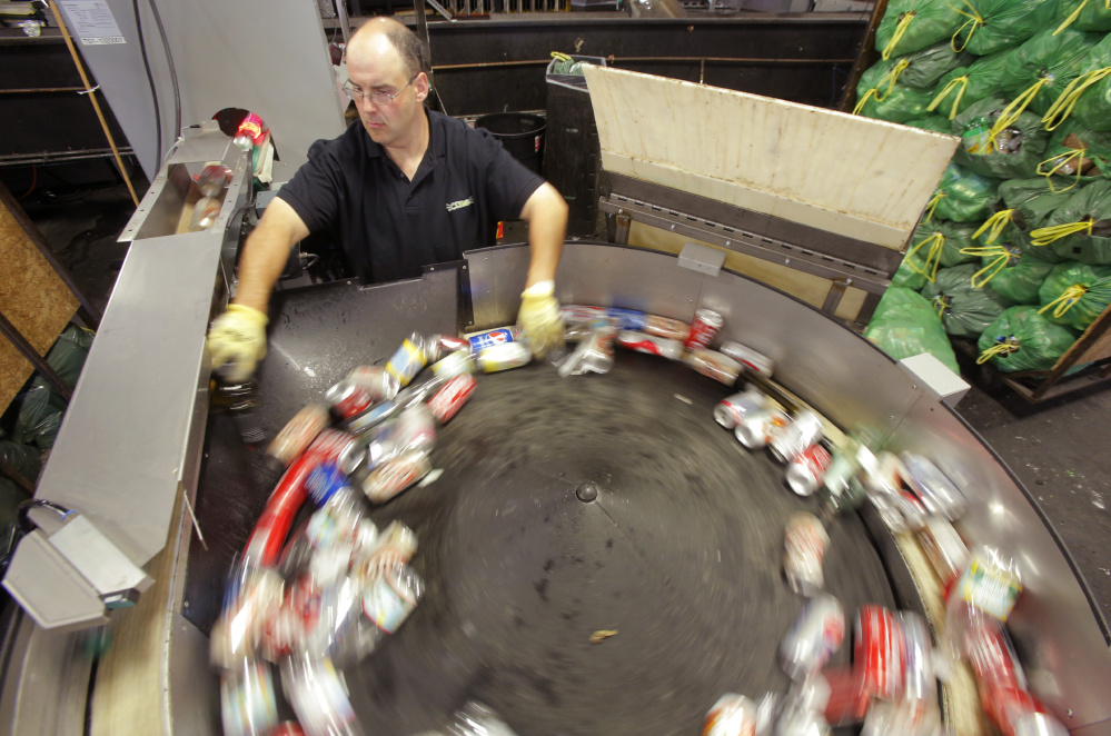 Joe Heroux works at a machine that counts bottles and cans at Clynk in South Portland on Wednesday. Clynk employs about 80 people in Maine and plans to have a staff of about 60 in the Greater Albany area of New York.